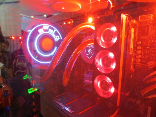 Red illumination, fans, and water-based cooling devices has made this modded rig look fierce!