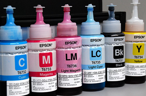 The Epson L800 is a six-color (Black, Yellow, Cyan, Magenta, Light Cyan, and Light Magenta) printer that uses a pre-installed ink tank system. These are the 6 ink bottles included in the package.