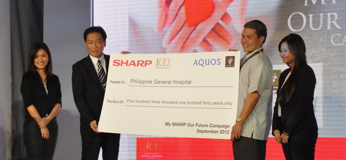 President Tanaka ceremonially grants Sharp Philippines' donation to the Philippine General Hospital (PGH).