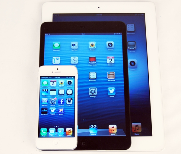 Seen here are the Apple iPhone 5, iPad Mini and the first gen-iPad.
