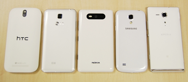 The rear shot of the five phones. <br> From left to right: HTC One SV, LG Optimus F5, Nokia Lumia 820, Samsung Galaxy S4 mini, Sony Xperia SP.