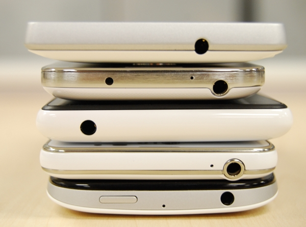 The top view of the five phones. From Top to bottom: Sony Xperia SP, Samsung Galaxy S4 mini, Nokia Lumia 820, LG Optimus F5, HTC One SV.