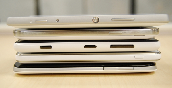 A shot of the right side of the devices. The Sony Xperia SP (top) and the Nokia Lumia 820 (center) are the only two devices in this article to come with a dedicated camera shutter button.