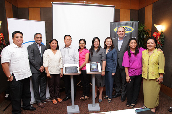 Executives from Intel Philippines and partner FELTA Multi-Media Inc. with representatives of the Department of Education, Makati, and Marilog Central Elementary School, Davao.