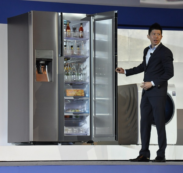 Samsung Singapore's Vice President for Consumer Electronics Stanley Goh presenting the Food ShowCase refrigerator at the SEA Forum 2014.
