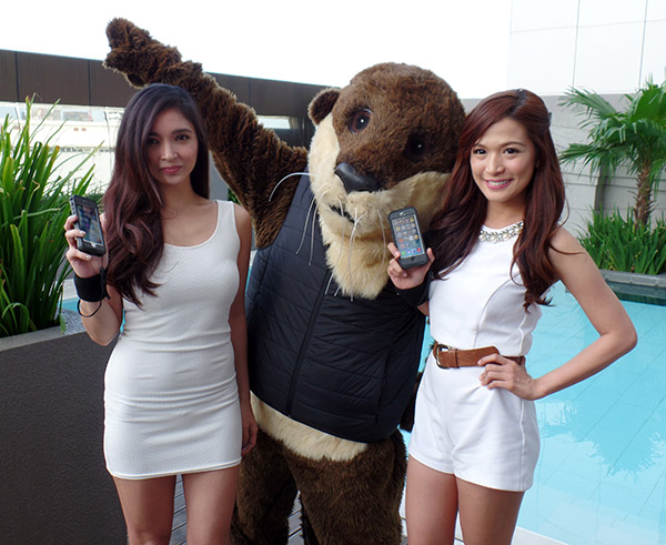 Models and the OtterBox mascot show off iPhones with the Preserver Series equipped.