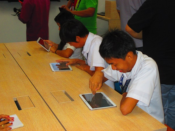 Students take a short examination on Samsung tablets after the teaching demo.