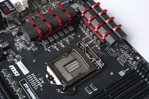 The LGA 1150 socket on this board is surrounded by heat sinks that look like dragon claws.