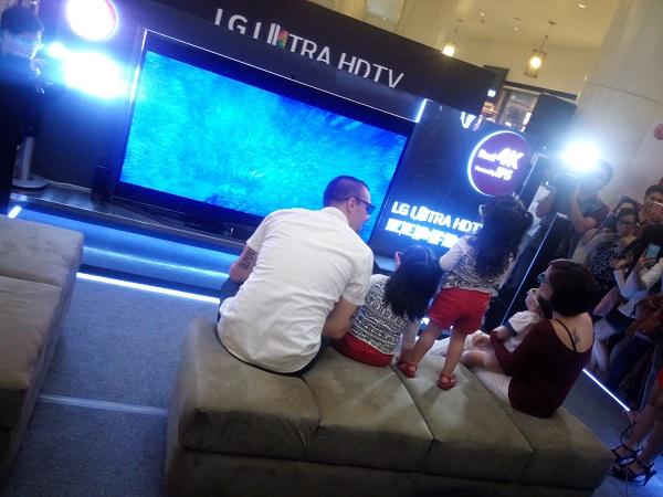 Team Kramer watching the LG Ultra HD TV with 3D eyeglasses.