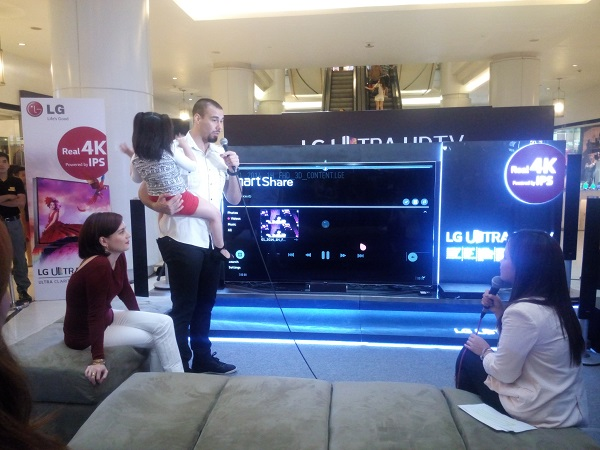 Doug is being interviewed by LG Philippines Marketing Communications Manager Jillian Lichauco regarding the features of the LG Ultra HD TV.